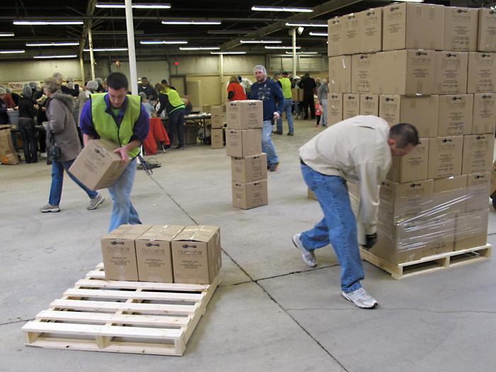 As boxes are filled with food, they get stacked and wrapped on pallets. This is how they'll make their journey to Haiti.