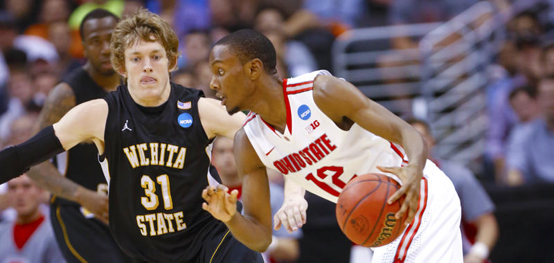 Ron Baker defends Ohio State's Sam Thompson in Los Angeles, Calif., March 30.