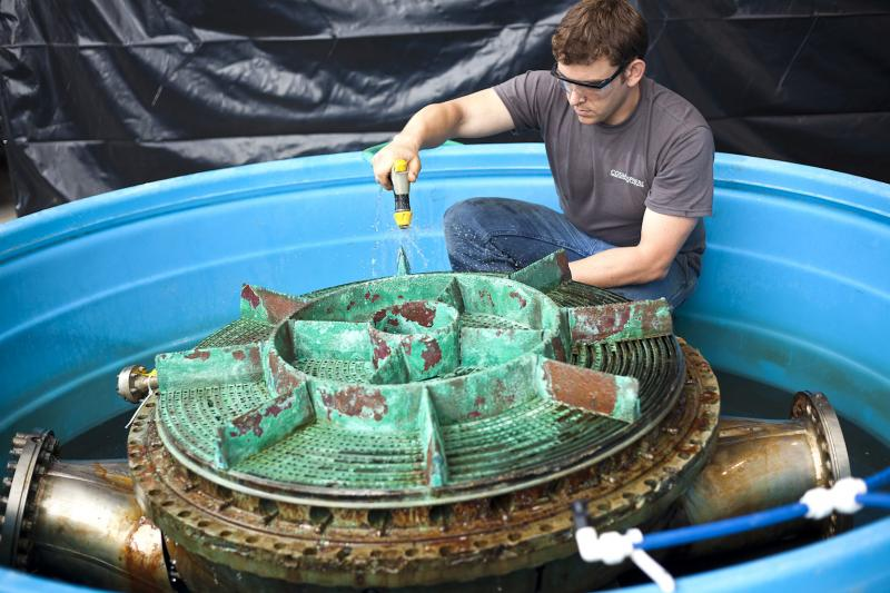 Jerrad Alexander, SpaceWorks Technician, working on the LOX (liquid oxygen) Dome. Each component undergoes daily treatment with freshwater and anti-corrosion agents to remove ocean debris and prevent further decay.