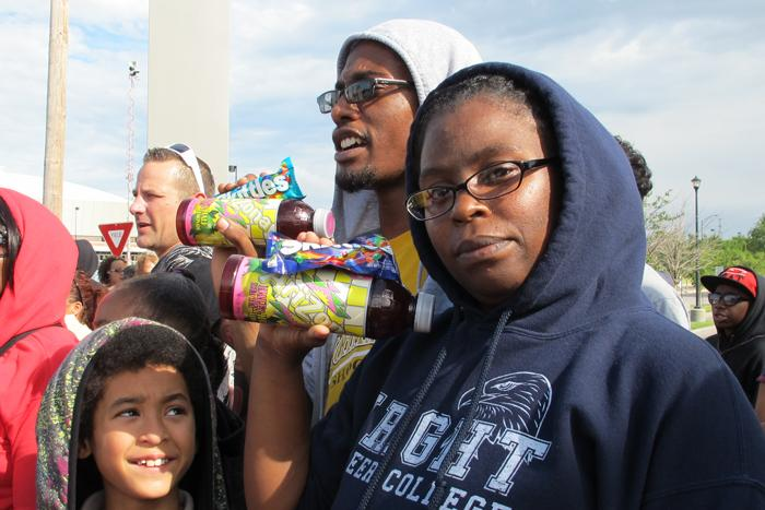 Armenta and Devon Wesley wore hoodies and held onto Skittles and ice tea at the rally supporting Trayvon Martin Monday night in Wichita.