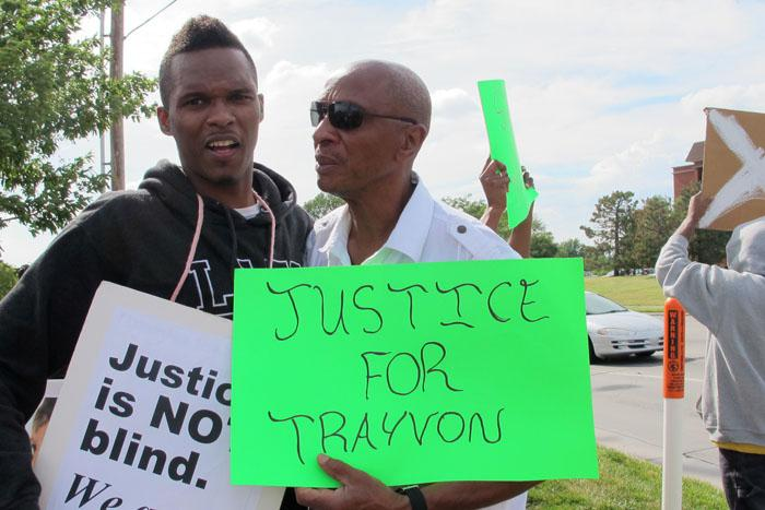 DeJuan Wash and Floyd Johnson Sr. were two of about a hundred people who rallied in support of Trayvon Martin in Wichita Monday night.