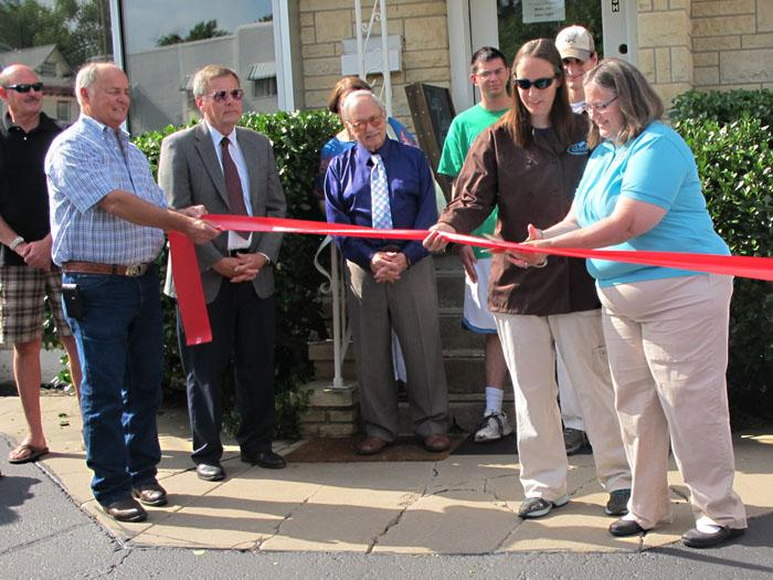 Pam and Darcy Bishop cut the ribbon in front of their new Cero's Candies store on Wednesday with Ed Cero and Mayor Carl Brewer in attendance.
