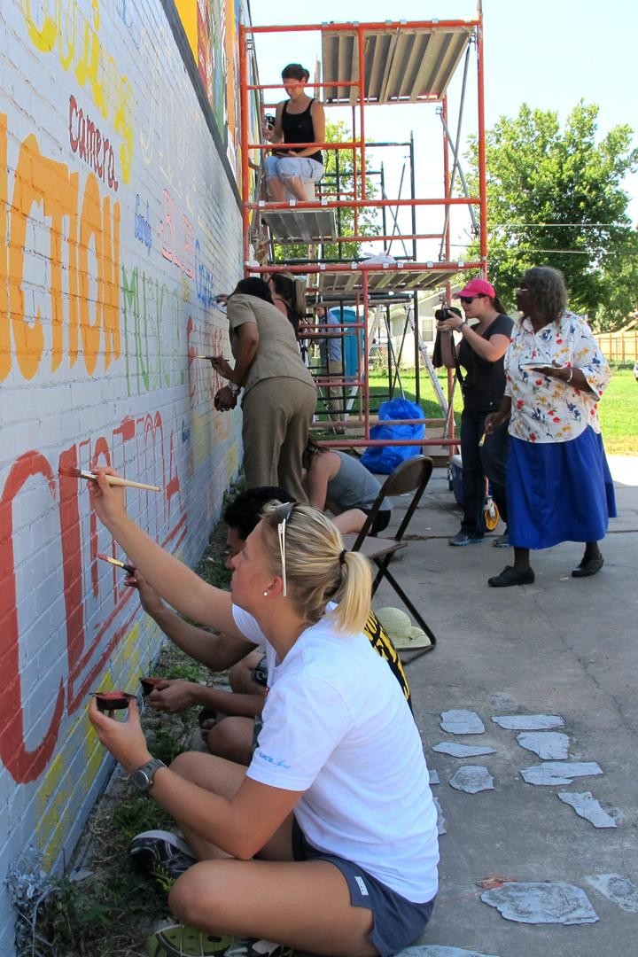 Community members join in with volunteers to help liven-up the Dunbar Theater.