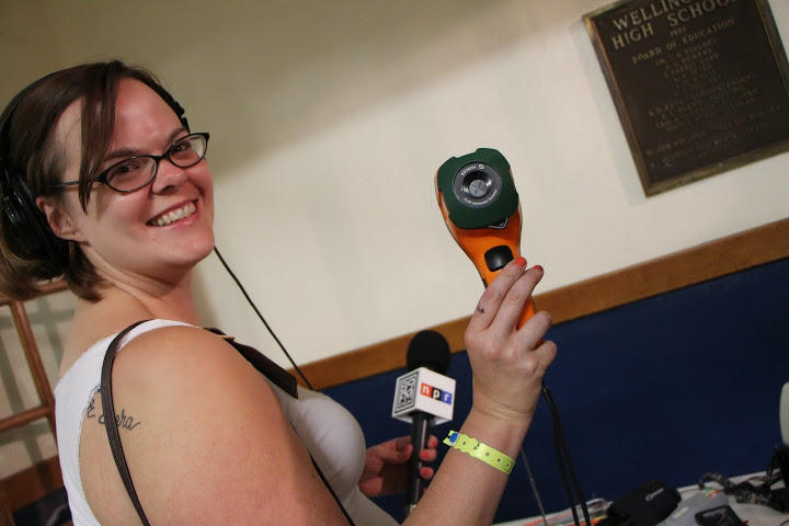 KMUW's Kate Clause holds a temperature gun, which ghost hunters use to read item temperatures at a distance.
