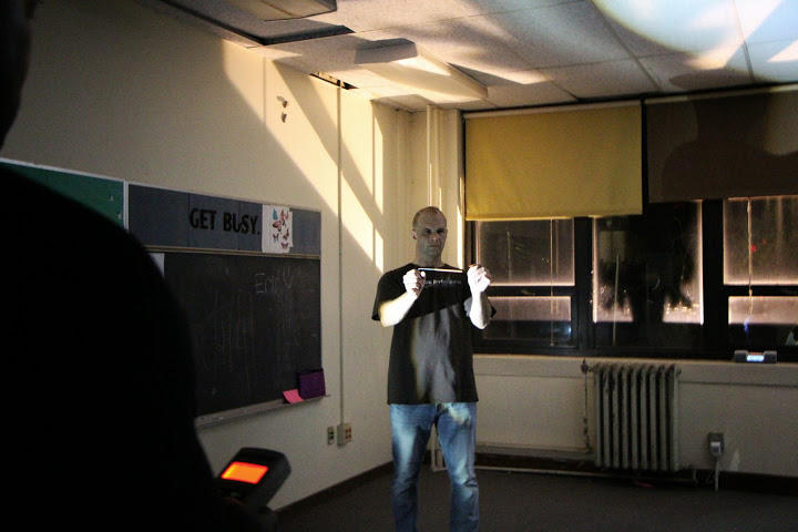 Darin Peterson uses dowsing rods to communicate with spirits in room 212.