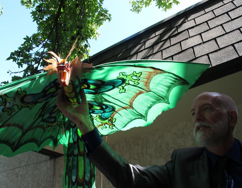 KMUW's general manager, Mark McCain, and his dragon kite.