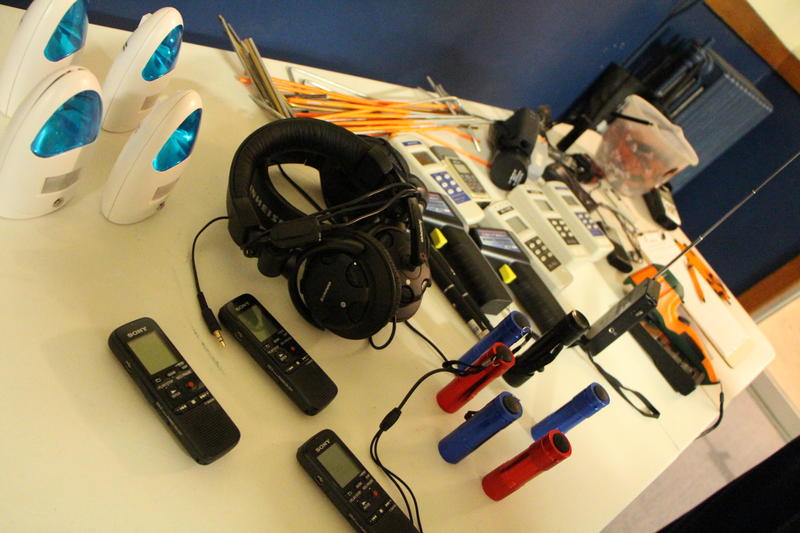 A table full of equipment for guests: recorders, motion censors, flashlights, dowsing rods and more.