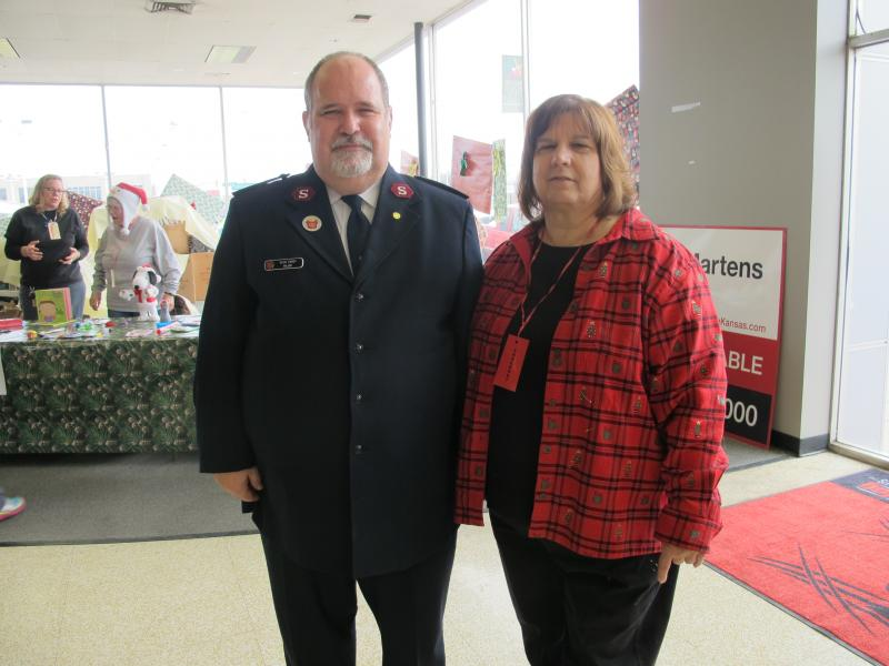 Major Glen Caddy, Wichita's Salvation Army City Commander, and Rosemary Niedens of Newman University. Niedens is on the Wichita Salvation Army's Board of Directors and loves holiday distribution time.