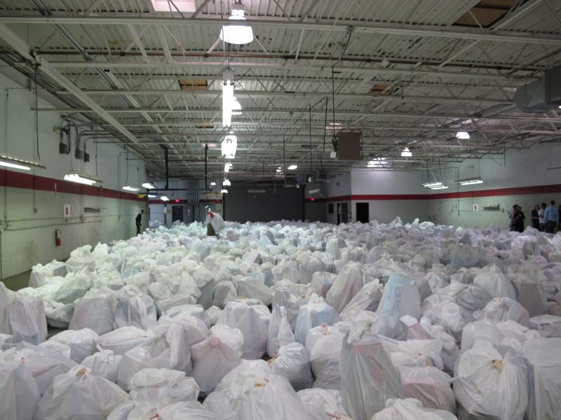 One of several rooms filled with bags for families at the Salvation Army distribution center