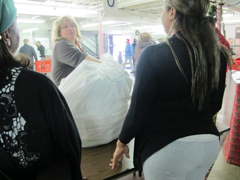 Salvation Army volunteers check each bag to make sure it contains the right items.