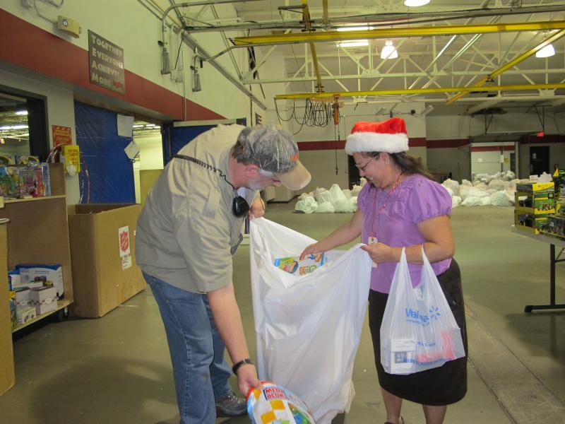 Volunteers make sure each bag has enough toys.