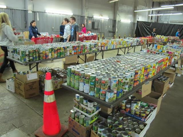 At Operation Holiday on east Kellogg, student volunteers help sort canned food.