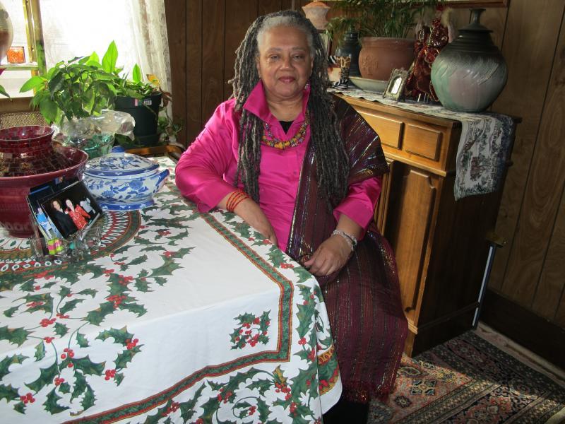 Wichita State Alum Wakeelah sitting in her home.