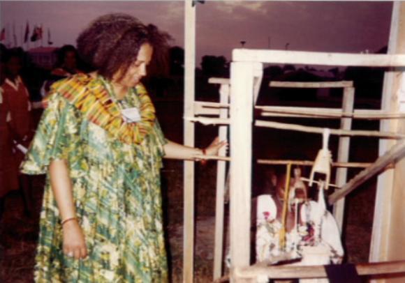 Wakeelah watches the natives of Ghana weave.