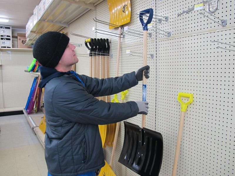 Brian Sollo buys shovel at a hardware store in east Wichita.