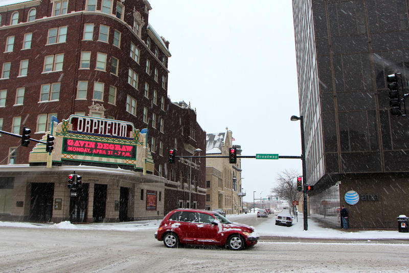Snow falls hard in front of the Orpheum Theater on Broadway.