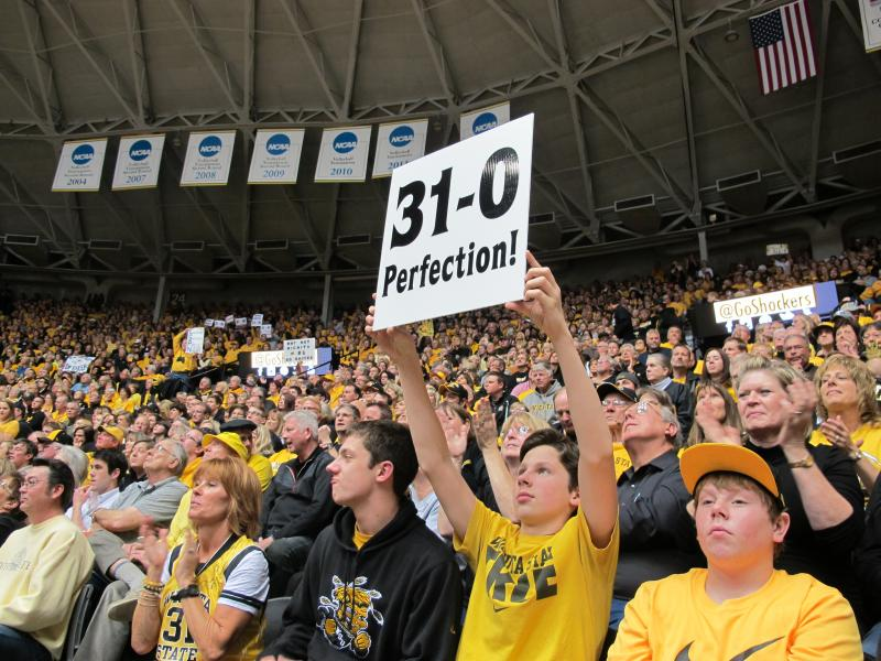 "A sold out Charles Koch arena was filled with a sea of black and gold cladded fans chanting ""undefeated"" as they lift up signs that read 31-0."