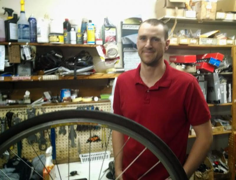 Aaron North in the repair shop at Wichita's Bicycle Pedaler