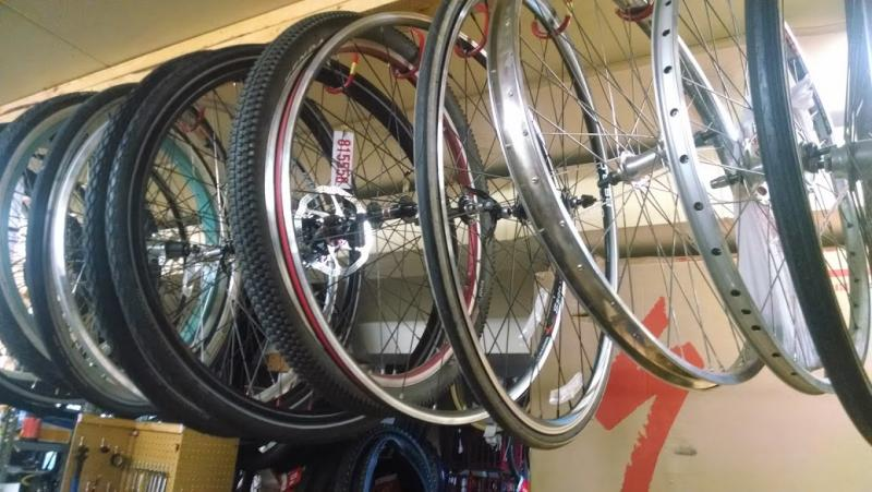 A row of bike wheels in the repair shop at Bicycle Pedaler