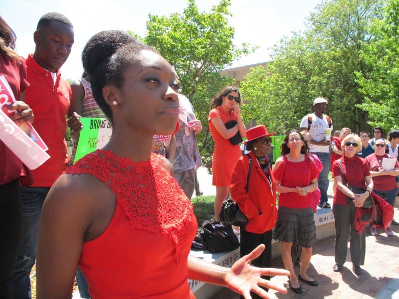 Graduate student Idia Tokunboh addressed the crowd.