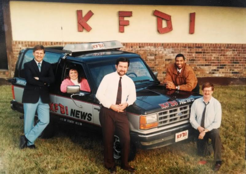 "A promotional photo of the ""KFDI Pony Express News Team."" From left: Ken Vandruff, Becky Zoglman, Dan Dillon, John Wright and Bill Roy."