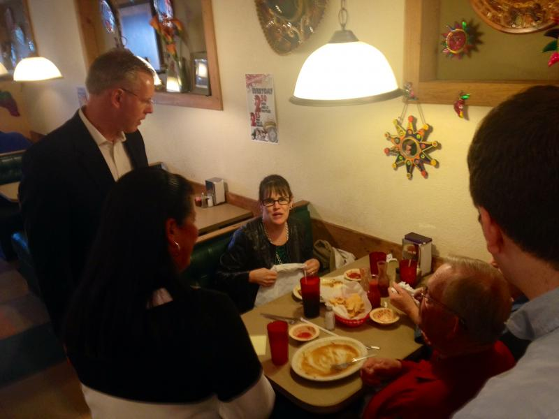 Democrat Paul Davis speaks with diners at Connie's Mexican Grill in Wichita. Davis is running against Gov. Sam Brownback in November's gubernatorial election