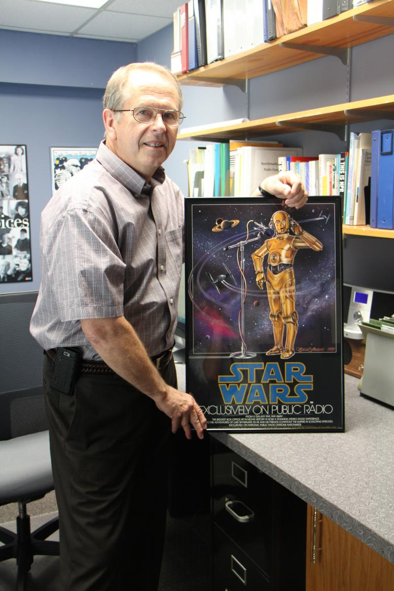 "Wood attended a sneak preview of ""Star Wars"" at Fox Studios in 1977. A poster of the NPR adaptation of ""Star Wars"" hangs in the KMUW General Manager's office."