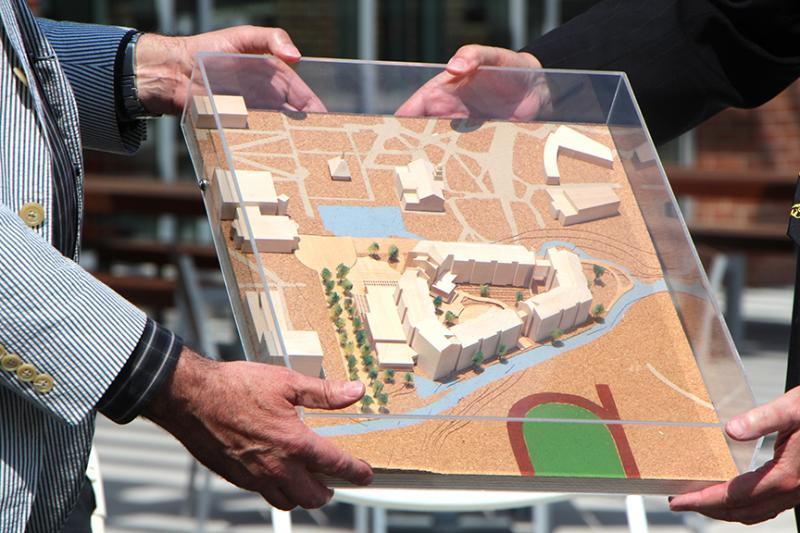 A diorama of Shocker Hall was presented to Wichita State University President John Bardo.