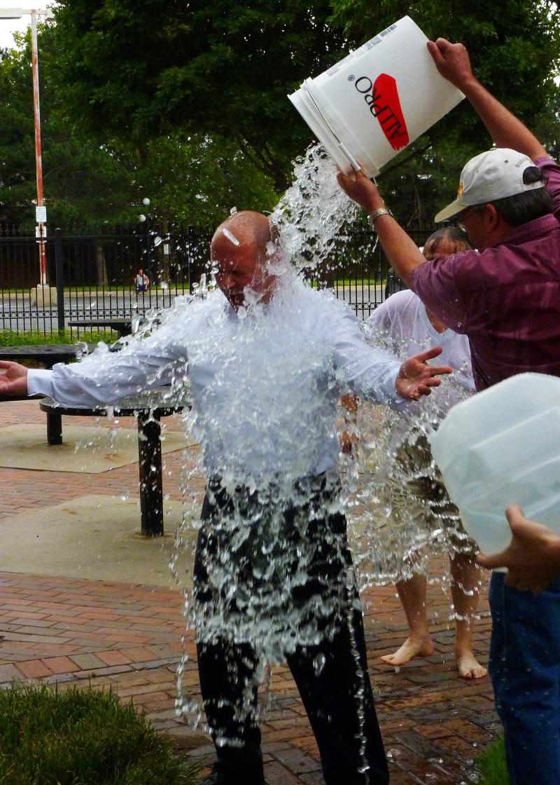 State Representative Steve Anthimedes is doused with water.