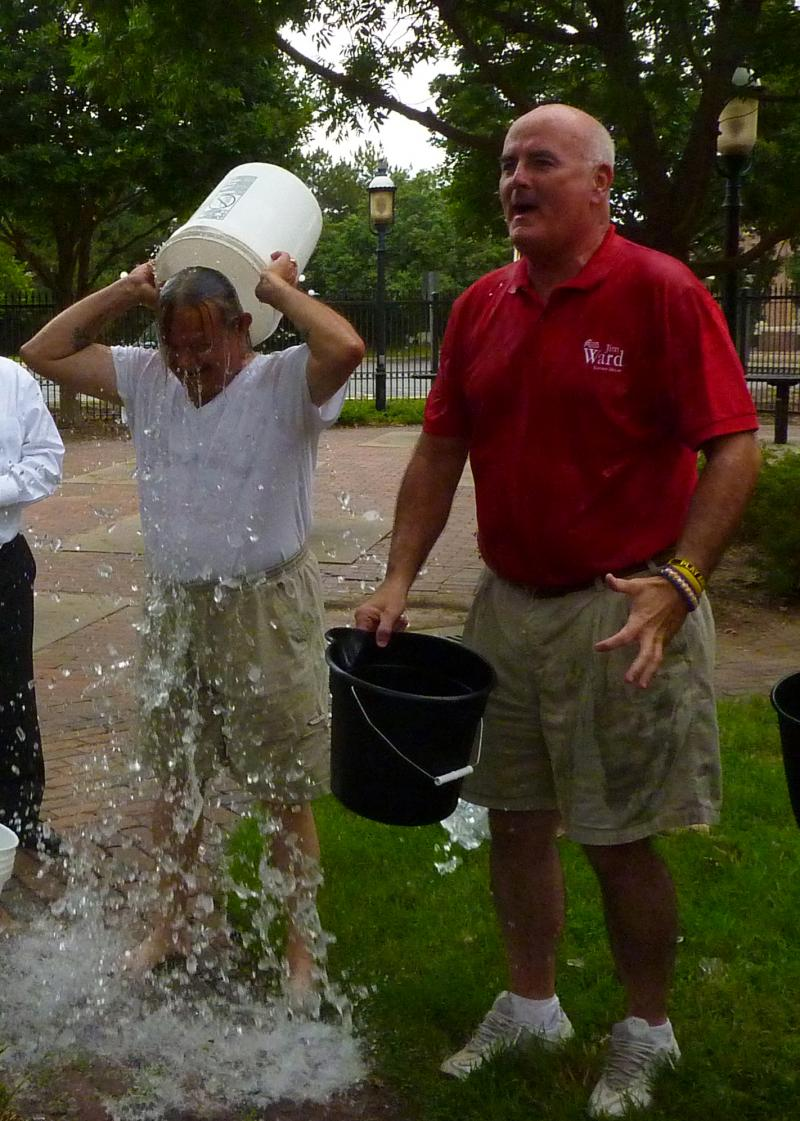 State Representative Jim Ward after he is drenched with ice water. State Representative Les Osterman does his challenge next to Ward.