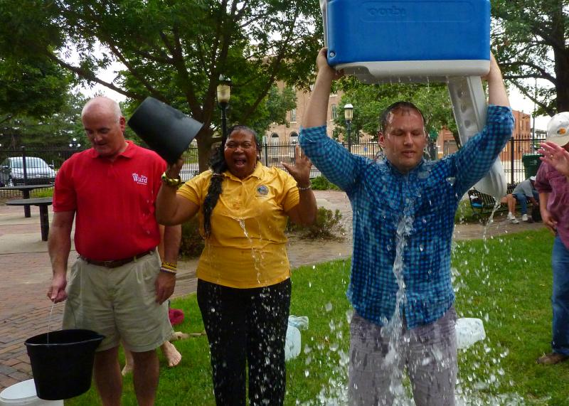 State Representative Brandon Whipple and State Senator Oletha Faust-Goudeau participate in the ice bucket challenge.