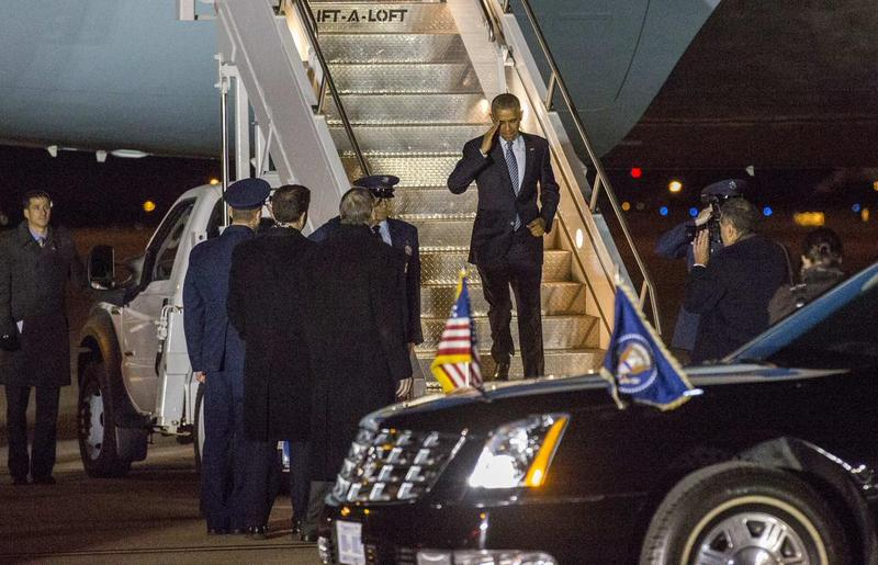 President Obama salutes Kansans as he exits Air Force Once in Topeka Wednesday night.