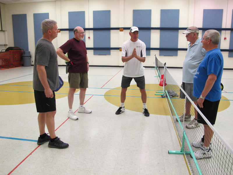 Scott Moore giving tips on playing pickleball at a clinic at the Downtown Senior Center in Wichita.