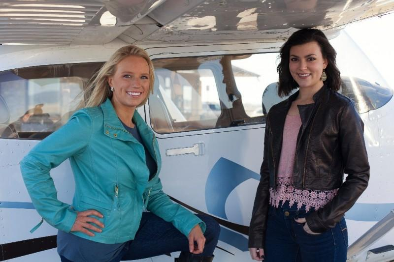 Tiffany Brown and Taylor Humphrey stand in front of a plane similar to the one they will pilot in the 2015 Air Race Classic.