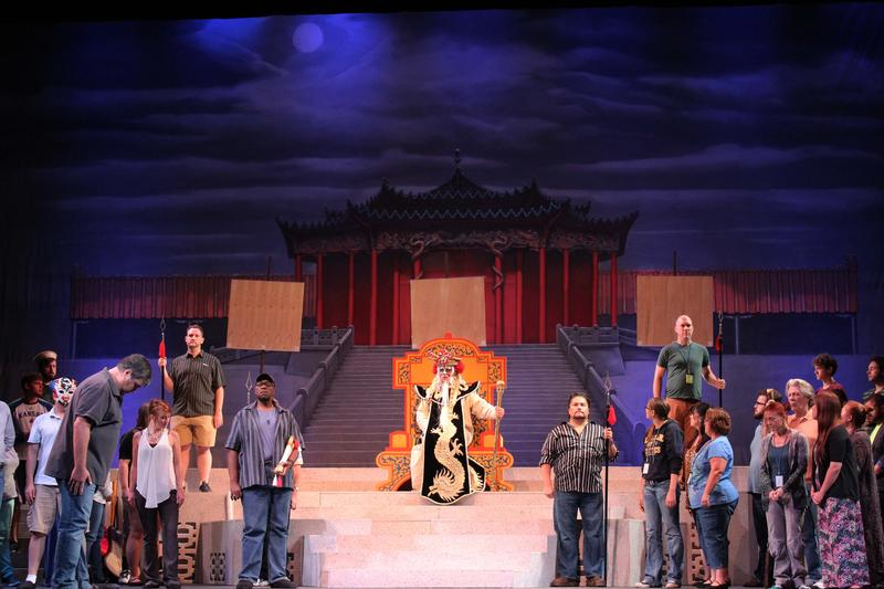 The cast of Turandot rehearses Monday ahead of Friday's only performance at Century II.