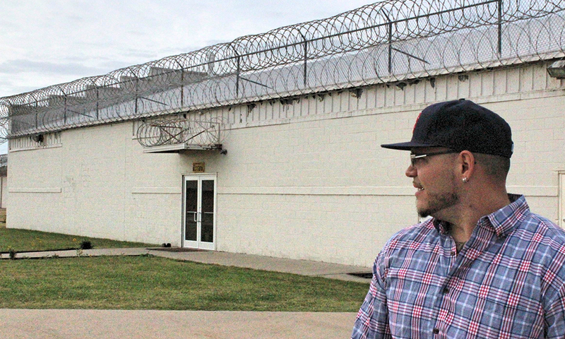 Tommy Galindo, a former inmate at Hutchinson Correctional Facility East, looks over the prison yard. Galindo now serves as a mentor to men incarcerated at the prison.