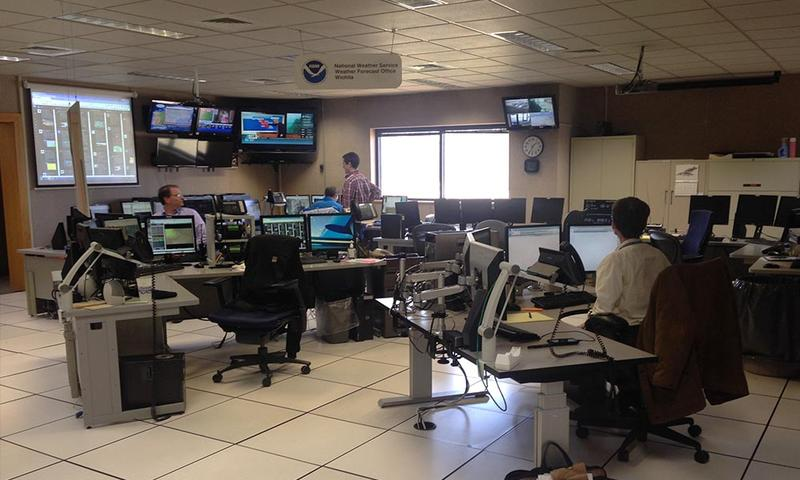 Meteorologists work at the National Weather Service office just west of Wichita's airport. They rely on data gathered by on-the-ground weather observers.