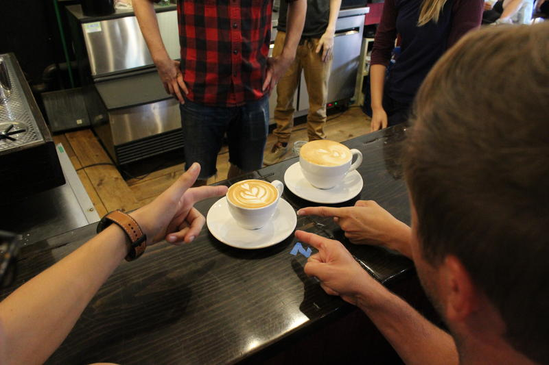The judges point to a winning piece of latte art.