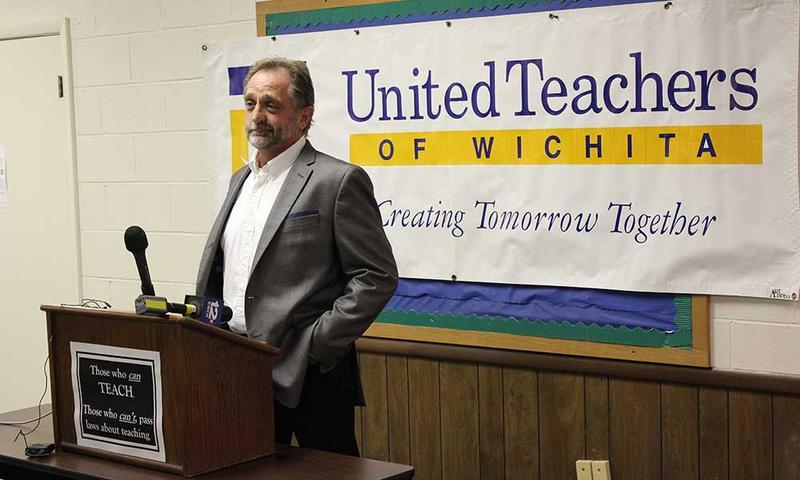 UTW President Steve Wentz speaks at a press conference.
