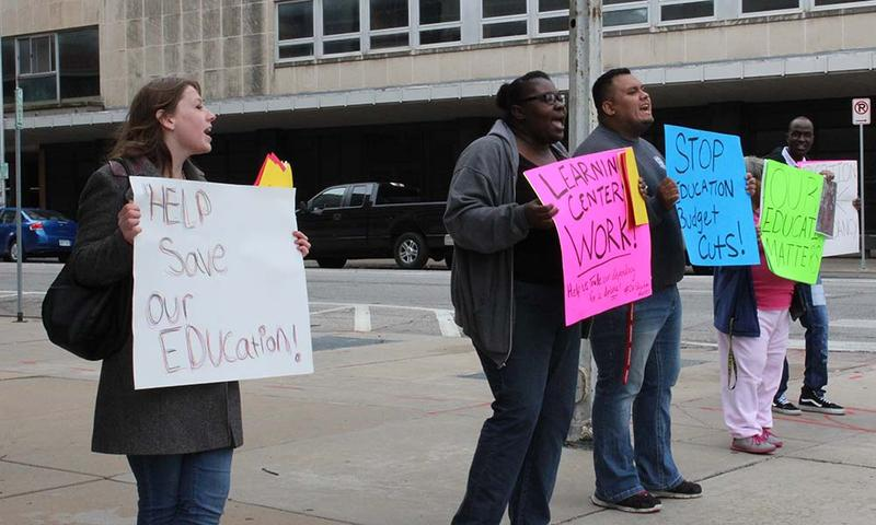 Students from Wichita's Chester I. Lewis Learning Center protest against its possible closure outside of the USD 259 administration building downtown.