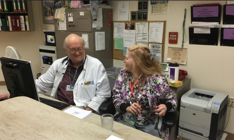 Dedon shares a joke with Jeanie Wyatt, a licensed practical nurse who has worked at the TMC-Lakewood nursing home for decades.