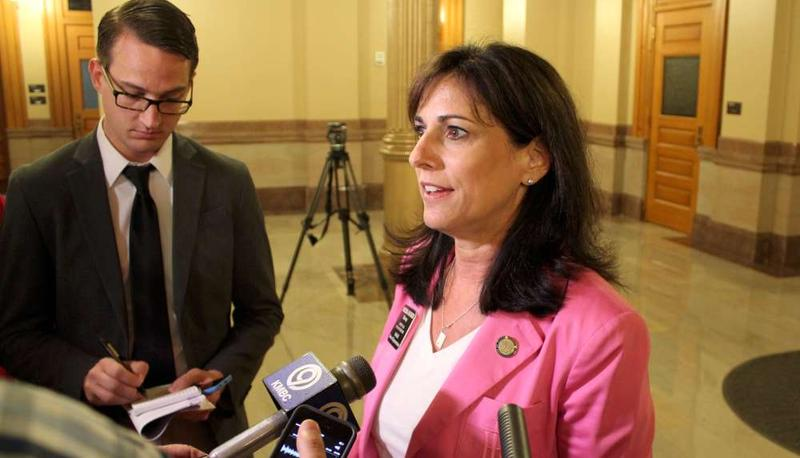 Moderate Republican Rep. Melissa Rooker is being credited with finding an alternative for school funding that didn't cut school aid.