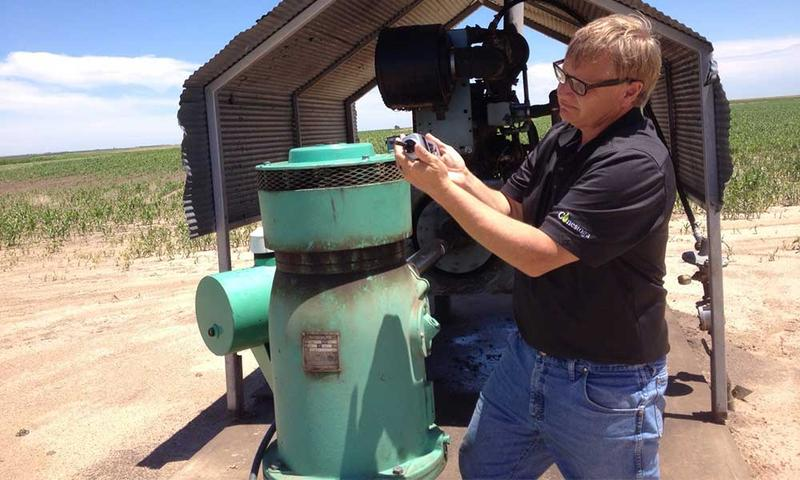 Tom Willis monitors the performance of one of his irrigation wells.