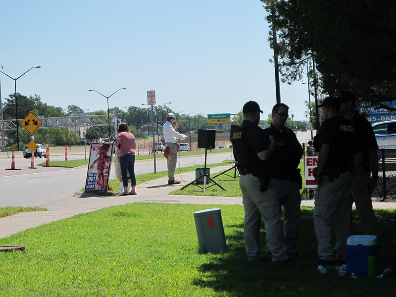 Operation Save America Protesters and Police Officers in front of the Trust Women South Wind Women's Center.