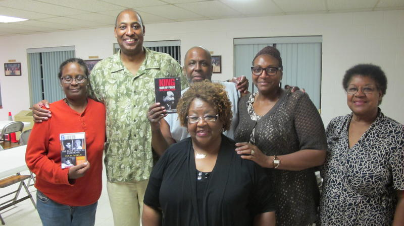 Godfrey Patterson, second from left, stands with some attendees of his Black History Video Series events.