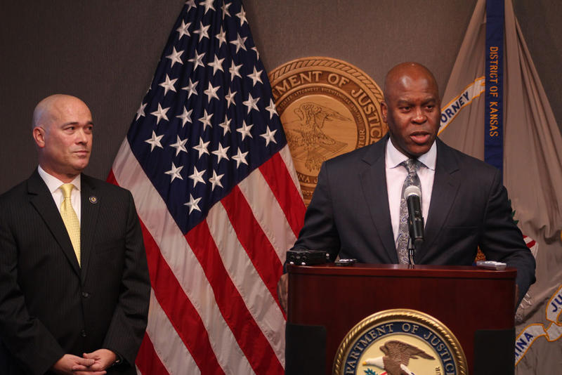 Acting U.S. Attorney Tom Beall, left, and FBI Special Agent in Charge Eric Jackson hold a press conference announcing the arrests.