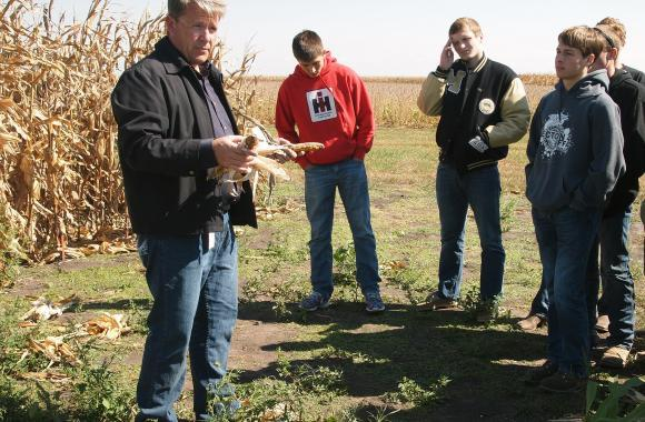 Monsanto's Troy Coziahr talks to high school students participating in a 'fantasy farming' competition.