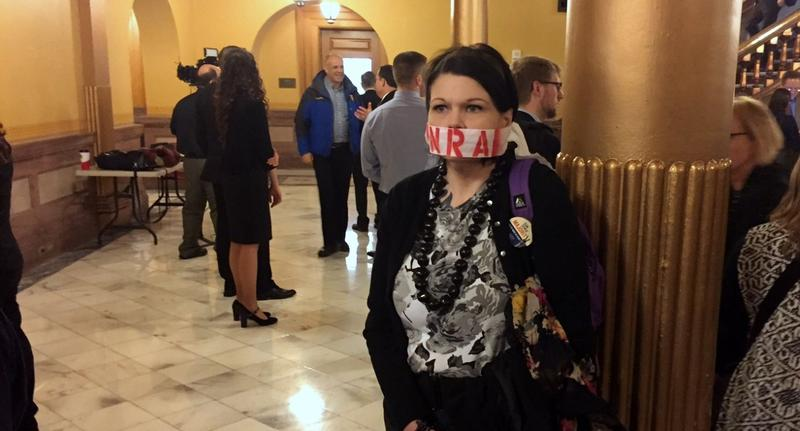 An opponent of the state's campus carry law outside the hearing Wednesday.