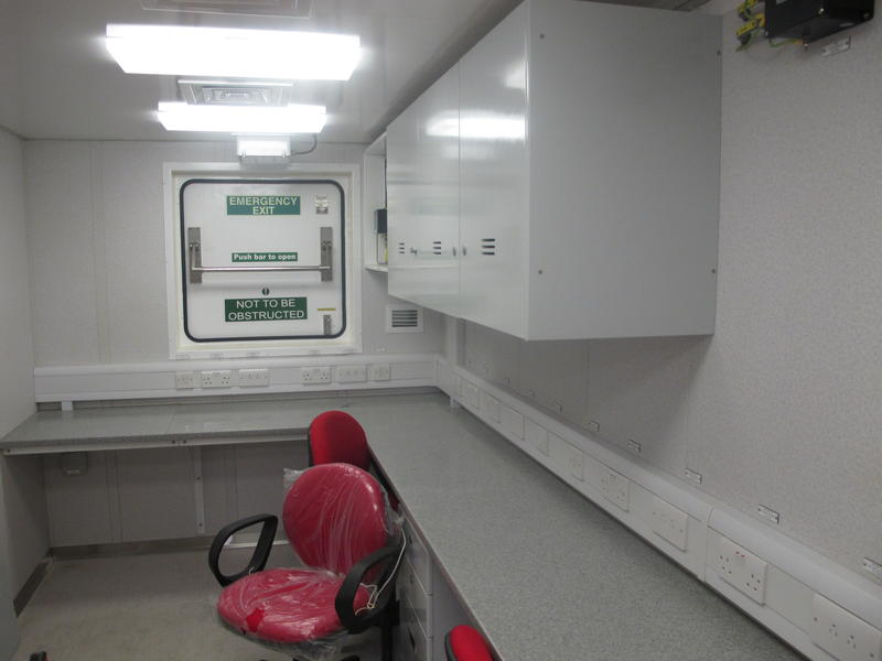 Inside a blast-resistant office that's designed to go on an oil-rig or ship.  It has escape hatches and is pressurized to keep gases or outside air from coming inside.