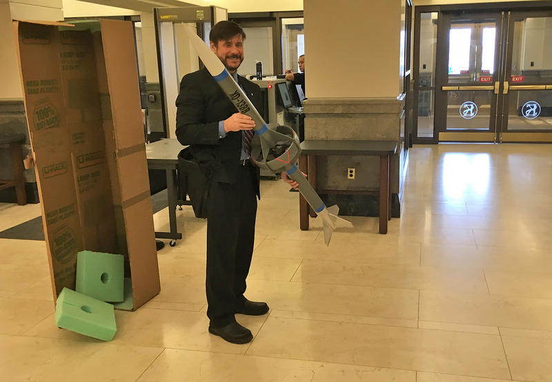 Ron Barrett-Gonzalez, an aerospace engineering professor at the University of Kansas, displays a model of a rocket he brought to show legislators an example of incendiary material he works with in his lab.